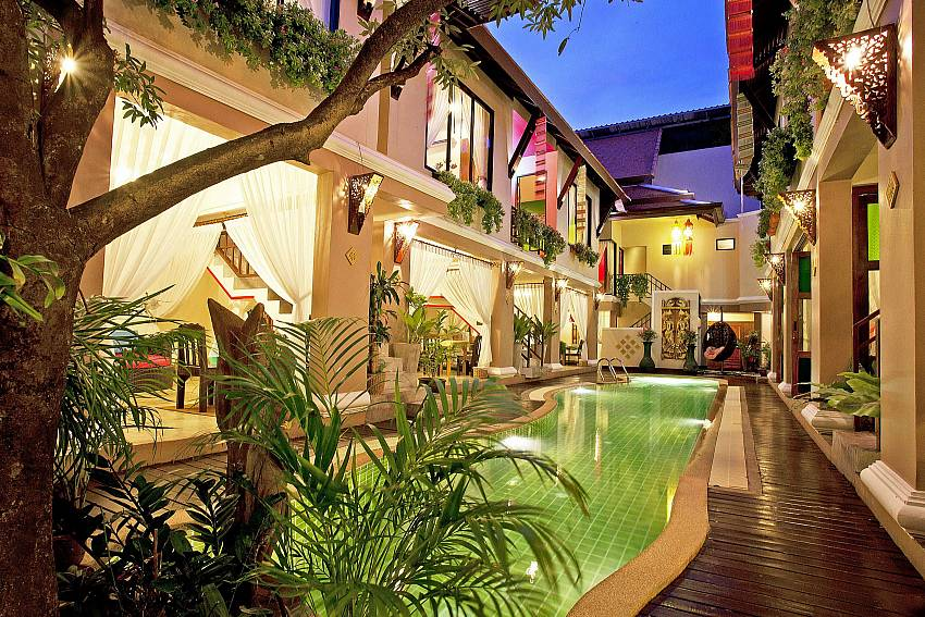 House with swimming pool at night time Of Jomtien Lotus Villa