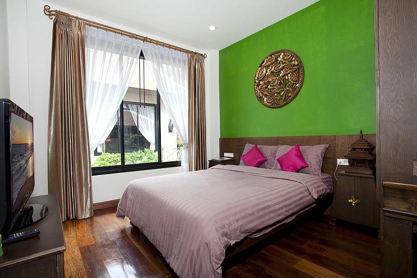 Bedroom views with TV and wardrobe Of Jomtien Lotus Villa (First)