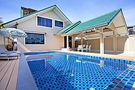 Blue interior swimming pool with cozy villa