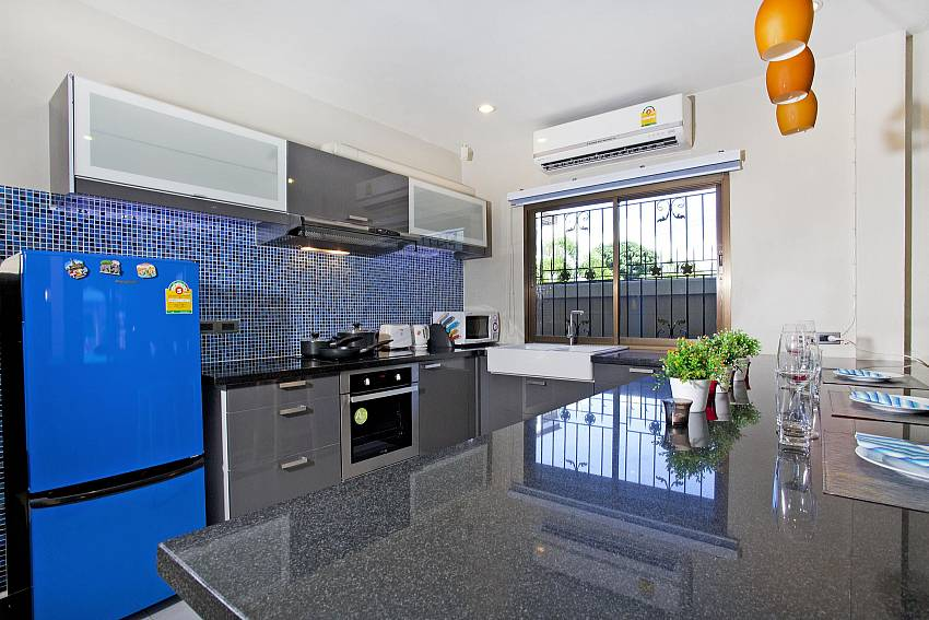 Kitchen room with refrigerator Of Villa Enigma