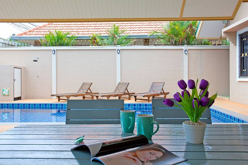 Private pool with sitting and lounging space at Villa Enigma Pattaya