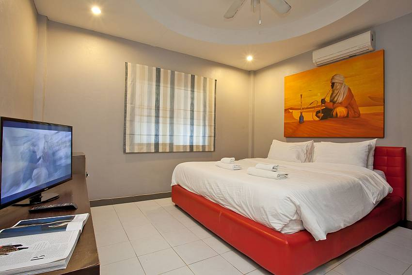 King size bedroom with TV at Villa Enigma in popular area of Pattaya