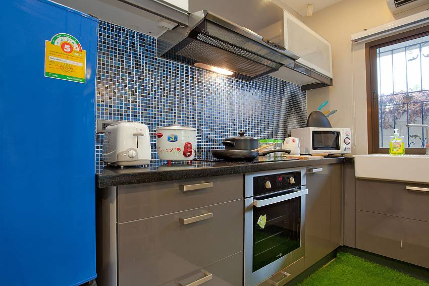 The modern kitchen is fully equipped at Villa Enigma South Pattaya