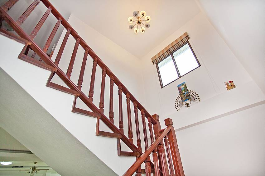 Wooden  staircase upstairs is decorated with lanterns on the ceiling Of Lanna Karuehaad Villa