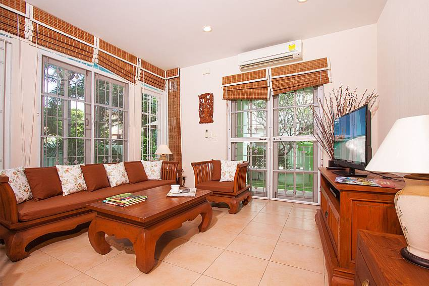 Living room with beautiful hard wood furniture at Jomtien Ascension B Pattaya