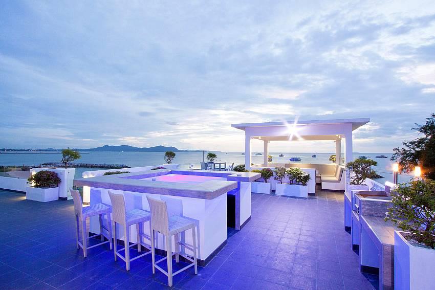 Dinning table at night time Of Na Jomtien Beachfront Villa