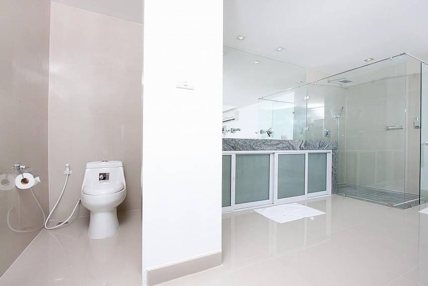Toilet with shower and basin wash Of Na Jomtien Beachfront Villa