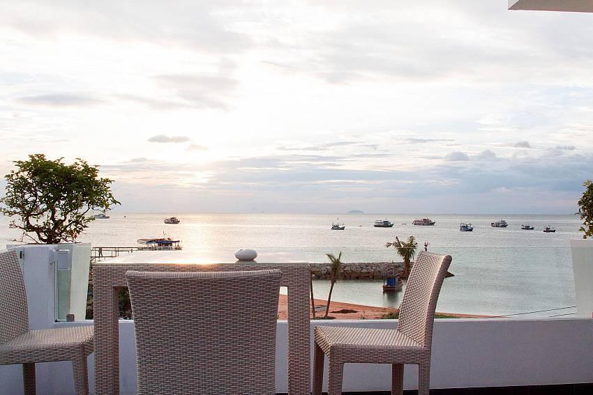 Dinning table overlooking the sea Of Na Jomtien Beachfront Villa