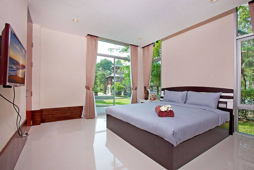 Bedroom overlooking outside Of Baan Mork Nakara Gorgeous (Four)
