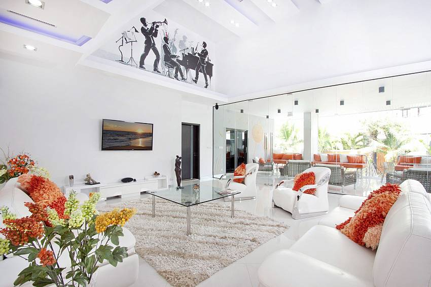 Living room is decorated with picture of art Of Royale Grand Villa