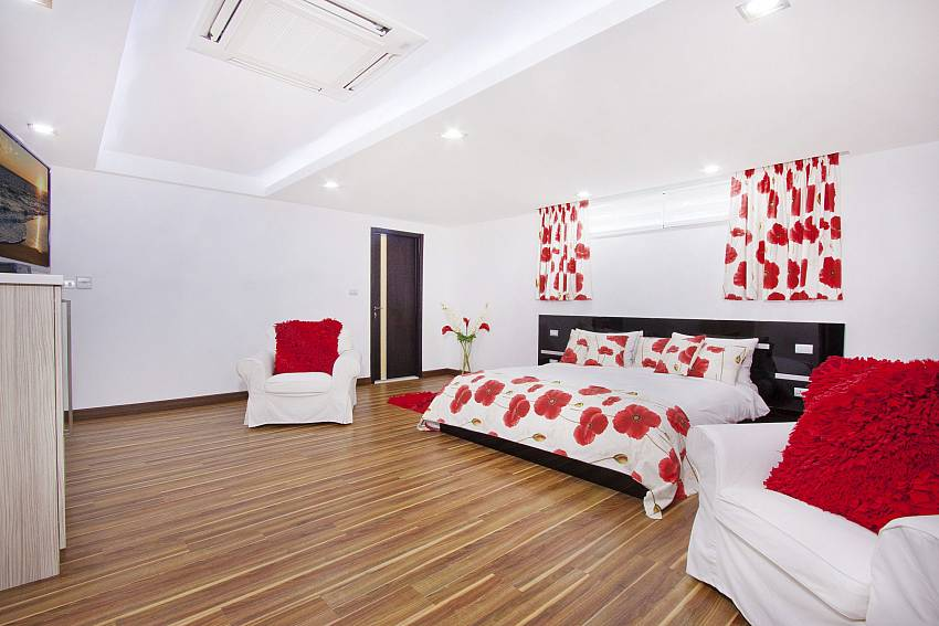 Red bedroom with TV and sofa Of Royale Grand Villa (Third)