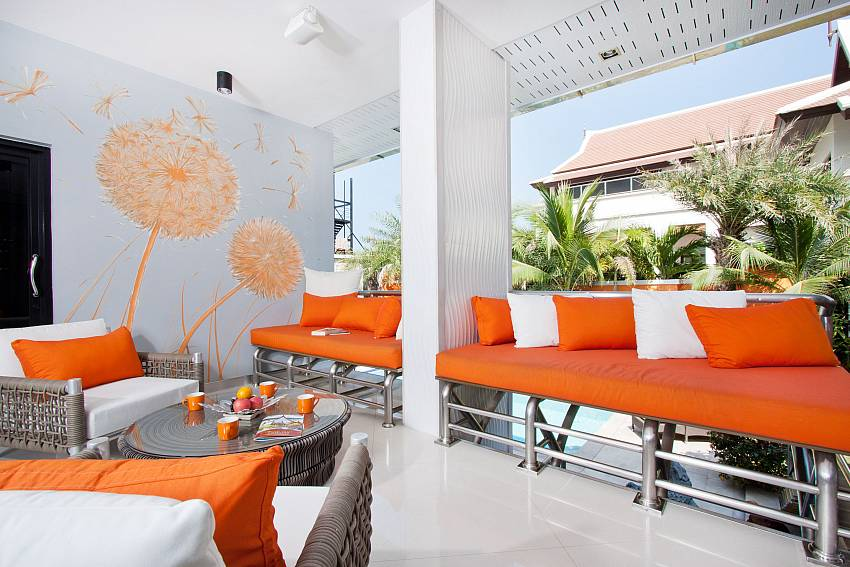 Orange sofa outside Of Royale Grand Villa