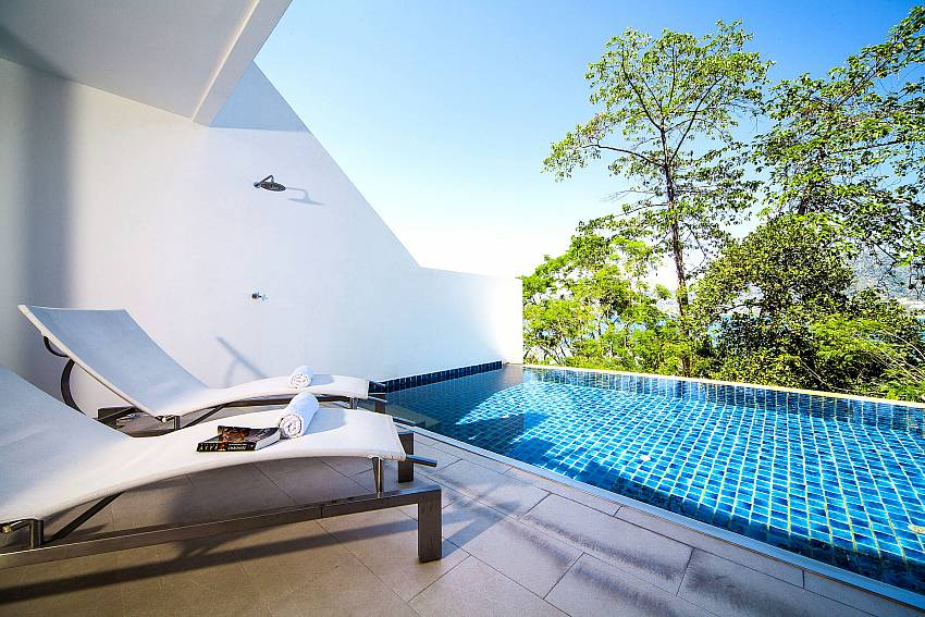 Sun bed outside by the pool Of Seductive Sunset Villa Patong A5