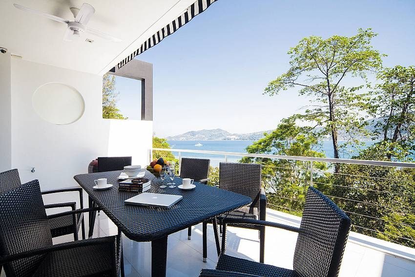 Dinning table outdoor overlooking trees and mountains Of Seductive Sunset Villa Patong A5