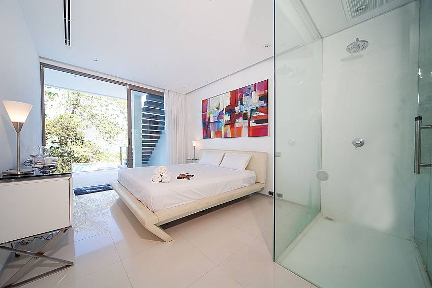 King size bedroom with ensuite bathroom at Seductive Sunset Villa Patong A5 in Phuket