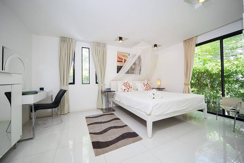 Twin bedroom  with garden views with desk Of Villa Chabah