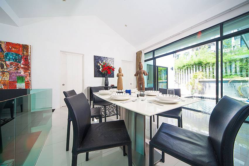 Open plan dining and living area at Villa Chabah in Kamela West Phuket