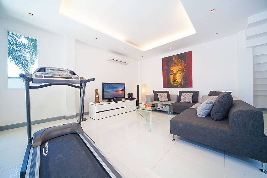 Living area with TV and fitness equipment in Villa Romeo West Phuket