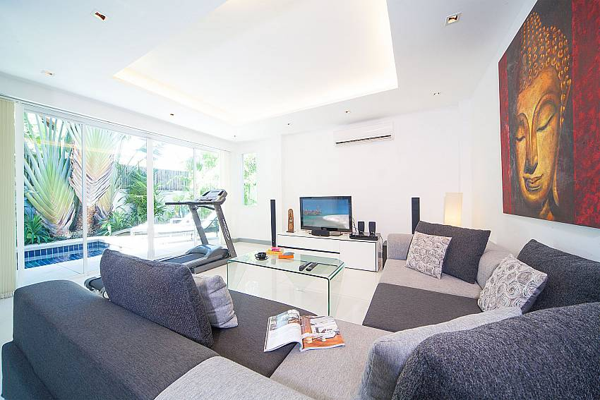 Spacious lounge with direct pool access at Villa Romeo in Kamela Phuket