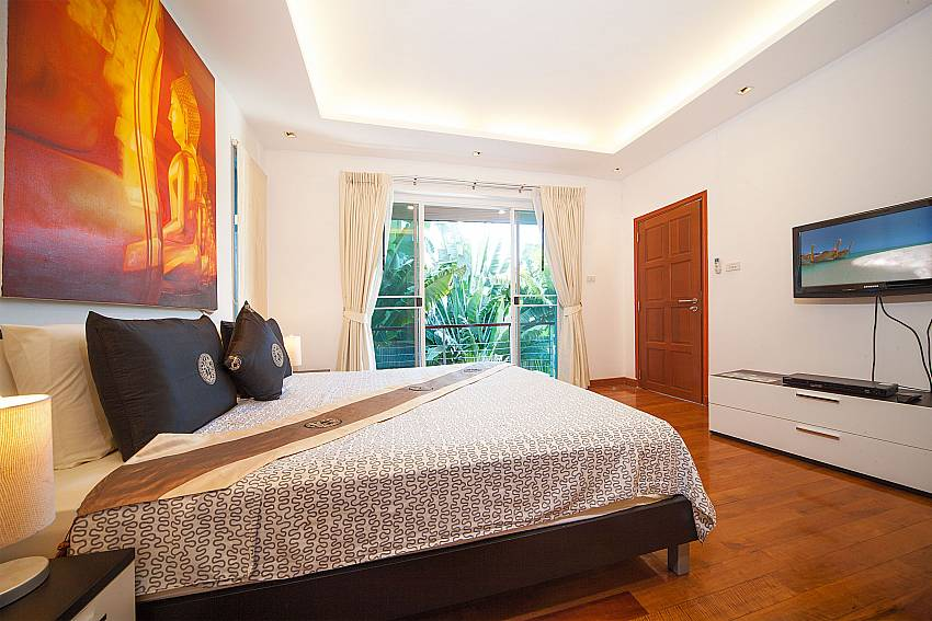 King size bed and TV at the master bedroom in Villa Romeo Phuket