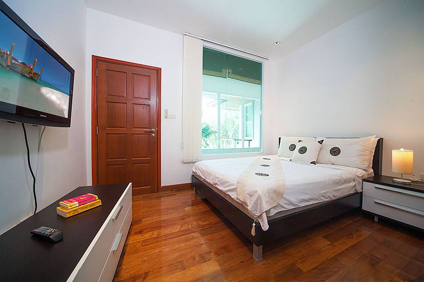 2. bedroom with king-size bed and TV at Villa Romeo West Phuket