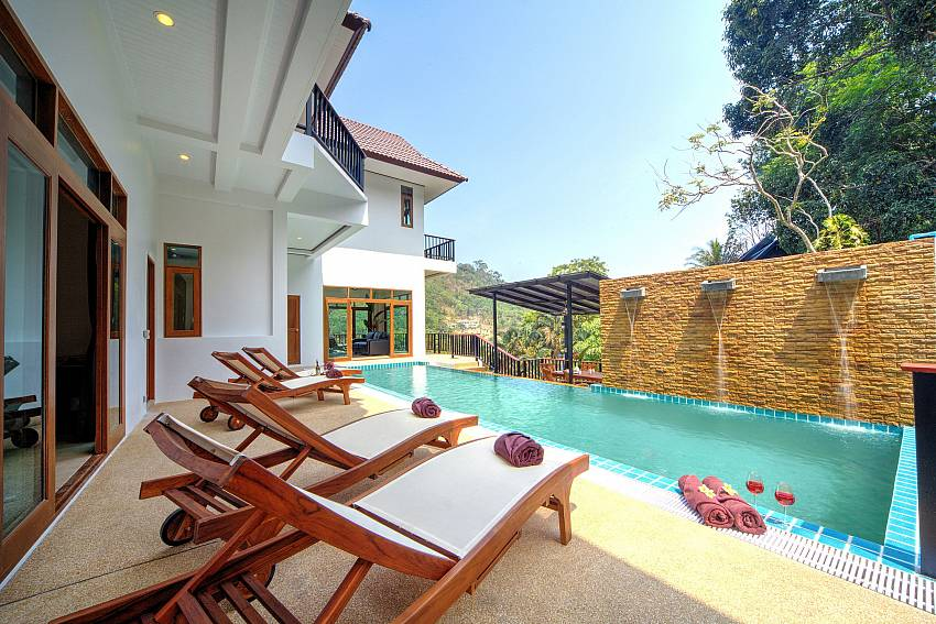 Sun bed by the pool Of Patong Hill Estate Seven