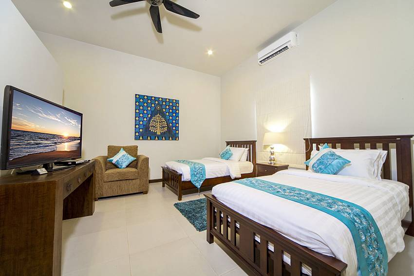 Double bedroom with sofa and TV Of Villa Hin Fa (Second)