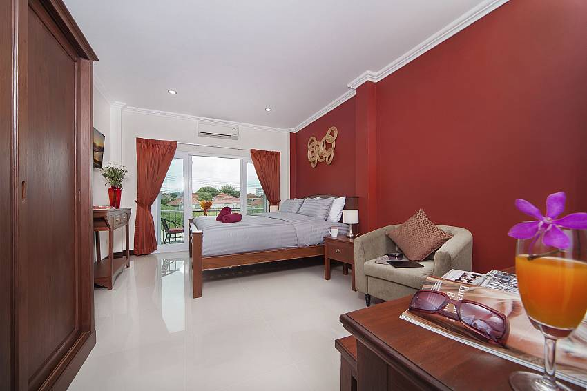Red bedroom with sofa and wardrobe Of Baan Calypso (First)