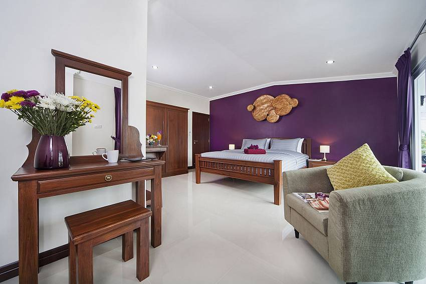 Purple bedroom with vanity and sofa Of Baan Calypso (Second)