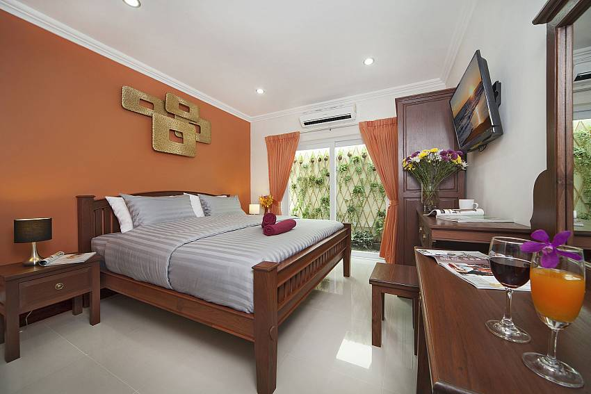 Bedroom Orange see views with wardrobe and vanity Of Baan Calypso (Five)
