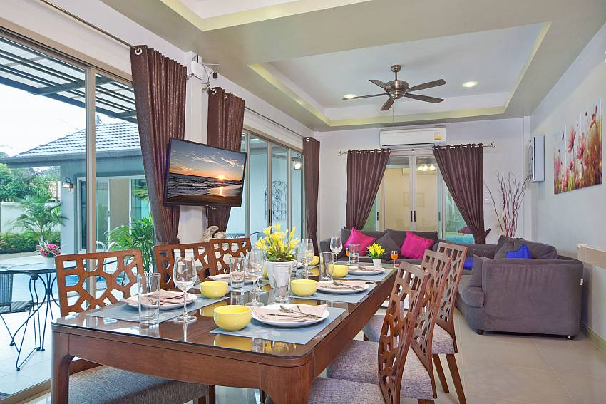Dinning table with TV near the living room Of Villa Naiyang