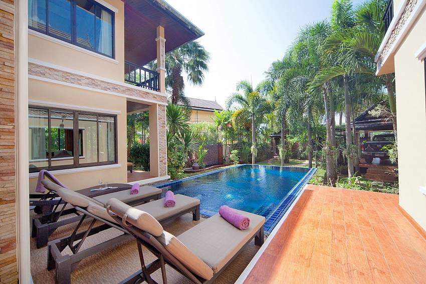 Swimming pool with sun bed Of BangTao Tara Villa 1