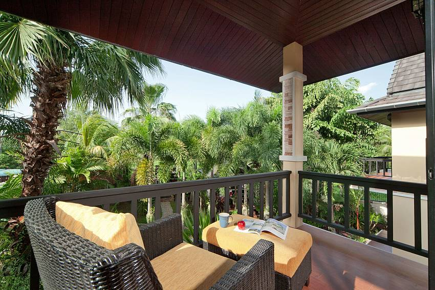 Lounging on balcony see views Of BangTao Tara Villa 1