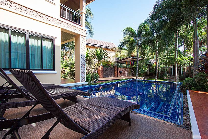 Sun bed by the pool Of BangTao Tara Villa 1