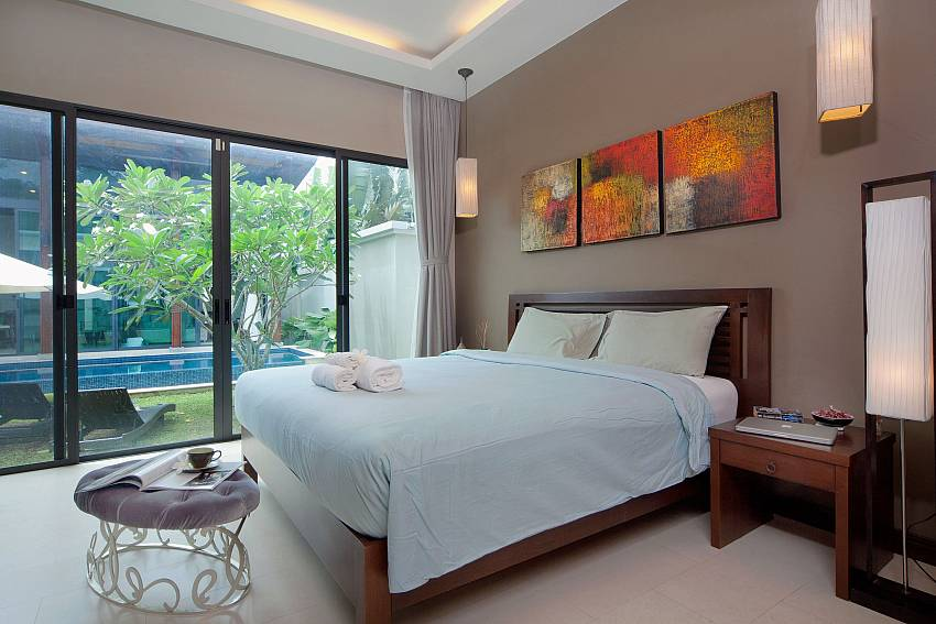 2. bedroom with king-size bed and pool access at Baan Wana 8 Phuket