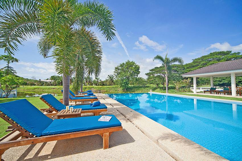 Sun bed by the pool Of Hua Hin Manor Palm Hills