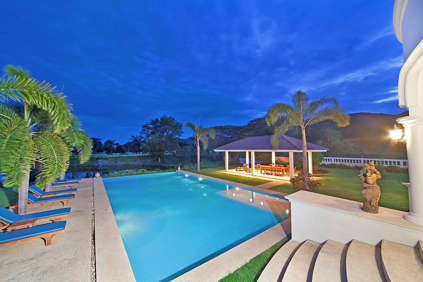 Swimming pool at night time Of Hua Hin Manor Palm Hills