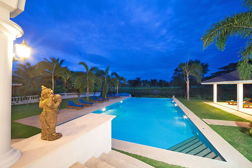 The pool is decorated with trees and sculpture Of Hua Hin Manor Palm Hills