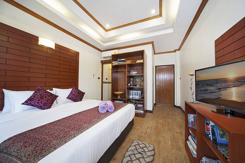 Bedroom with TV and wardrobe Of BangTao Tara Villa 4 (Third)