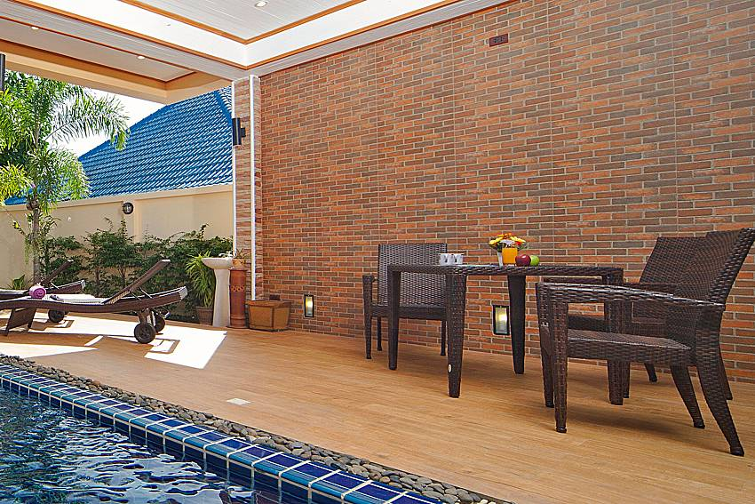 Shaded sitting area by the private pool at BangTao Tara Villa 4 Phuket