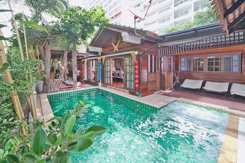 Swimming pool in front of the house Of Baan Ruean Thai