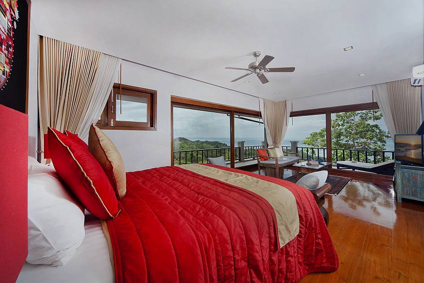 Red bedroom see view with TV and sofa Of Summitra Villa No.2 (First)