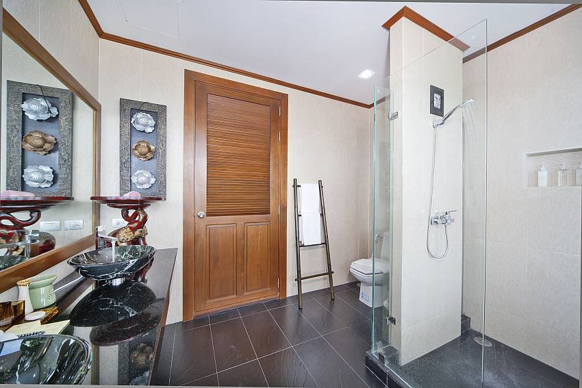 Bathroom with toilet and basin wash Of Summitra Villa No.2