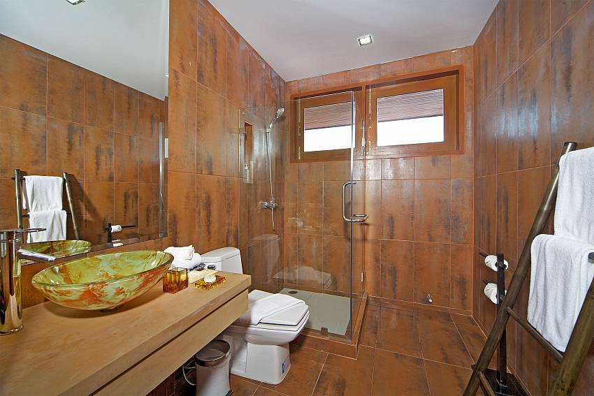 Basin wash with clothes rack in the bathroom Of Summitra Villa No.2
