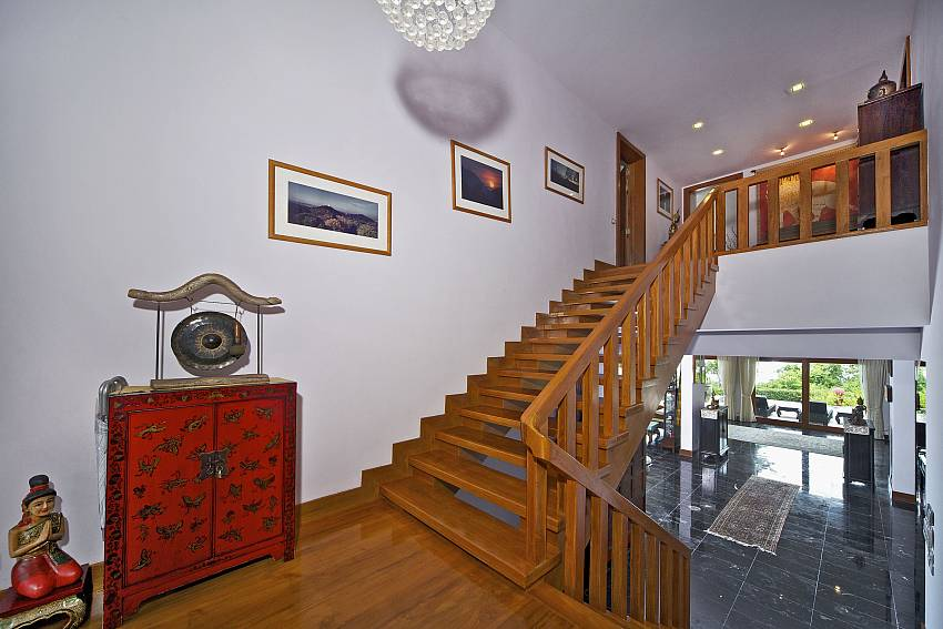 Wooden staircase upstairs is decorated with lanterns on the ceiling Of Summitra Villa No.2