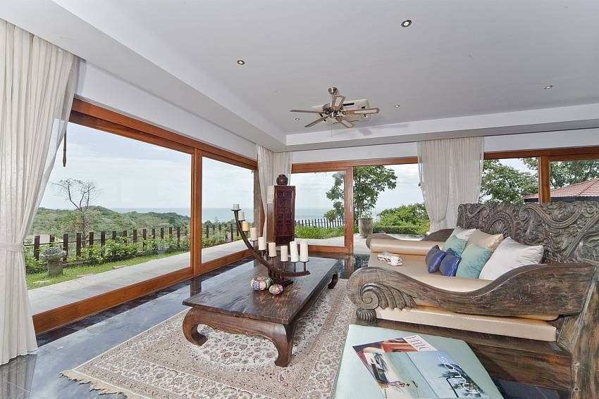 Living room with huge glass doors at Summitra Villa No. 2 Choeng Mon Samui
