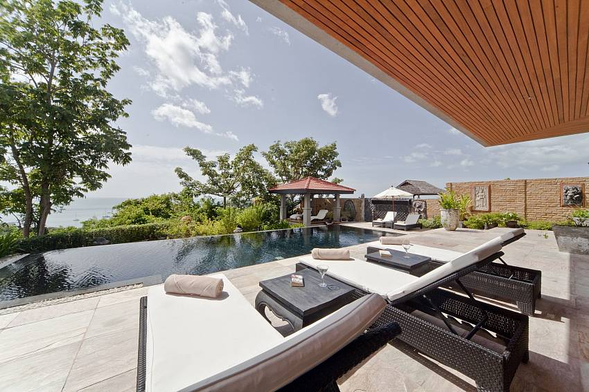 Sun beds by the private pool at Summitra Villa No. 2 Samui