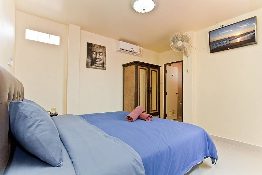 Bedroom with wardrobe and TV Of Villa Fiesta (Second)