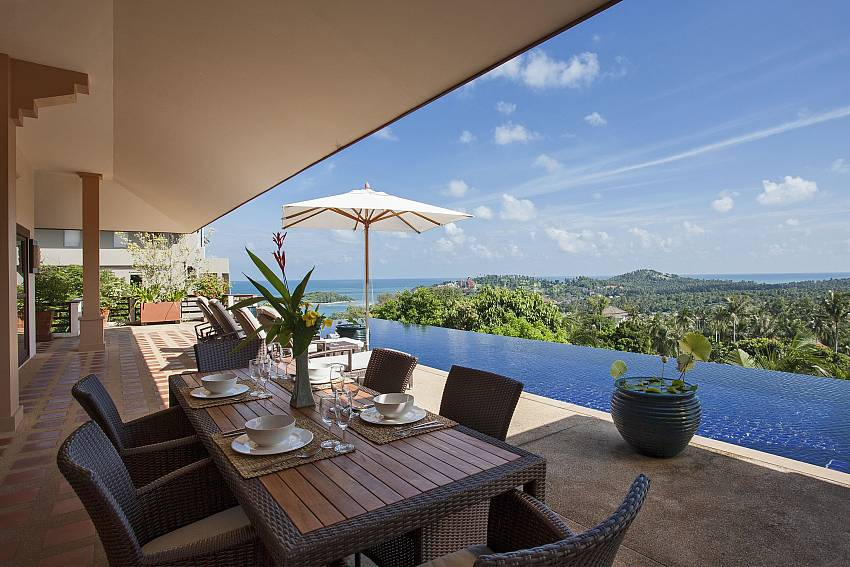 Dinning table outdoor near the pool Of Cape Summitra Villa