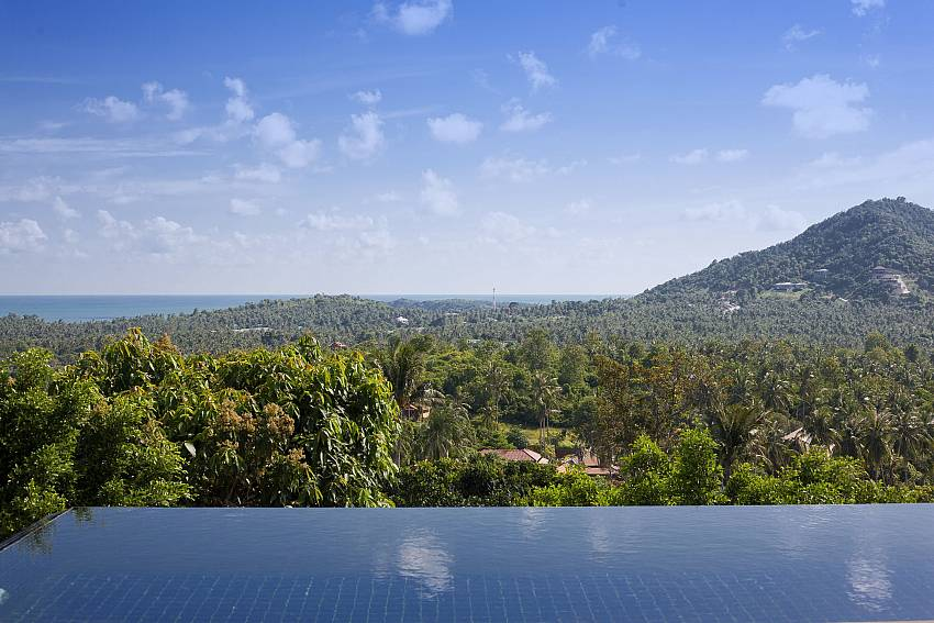 Swimming pool outdoor overlooking the trees and mountains Of Cape Summitra Villa